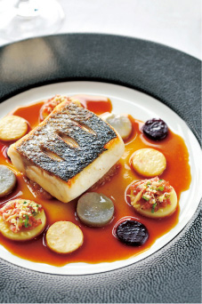Line-Caught Sea Bass Gratin Savoyard and Melted Onions in Morteau Sausage Jus